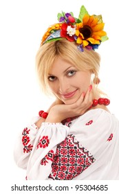 Attractive woman wears Ukrainian national dress isolated on a white background