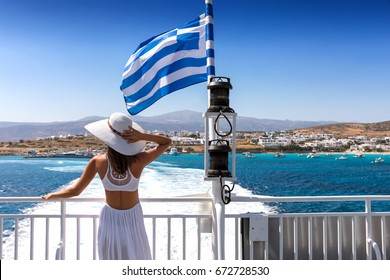 Attractive woman in a white dress on a Greek ferry boat traveling through the cyclades of Greece