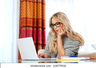 attractive woman writer in her home with laptop in creative process