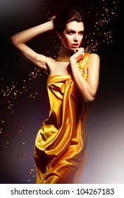 attractive woman in yellow dress