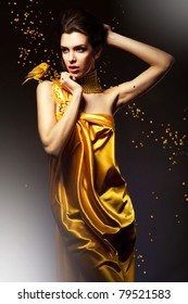 attractive woman in yellow dress with bird