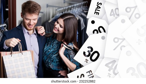 Attractive woman and young man go shopping at the store on sale
