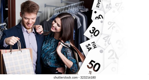 Attractive woman and young man go shopping at the store on clearance sale