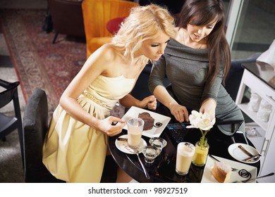 Attractive women browsing internet in a restaurant