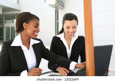 An attractive women business team (Focus on Asian Woman)
