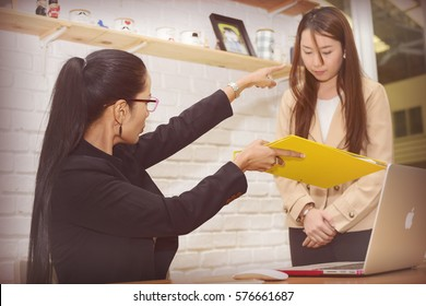 Attractive women Discussing with  Coworkers pointer finger to secretary.Process Sunny Office.work failed Concept.Working Online Project Desktop.Blurred