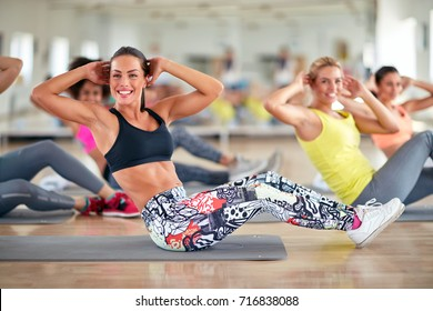Attractive women train in group on fitness class