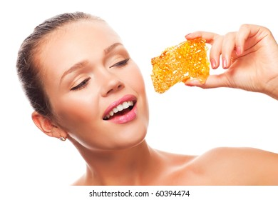 attractive young adult with tasty honeycomb isolated on white background