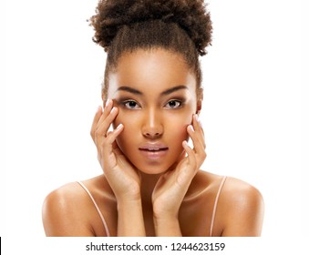 Attractive young african american girl touching her face on white background. Beauty & Skin care concept