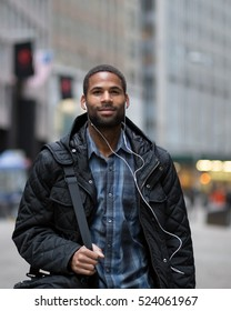 Attractive young African American man walking to work, photographed in NYC in November
