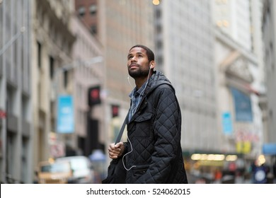Attractive young African American man looking up, photographed in NYC in November