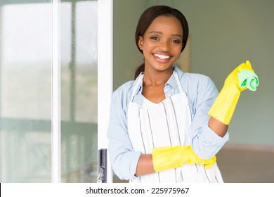 attractive young african girl holding dishcloth