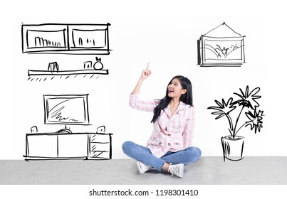 attractive young  asian business  woman thinking  dream house.Dreaming about new apartment. Cheerful young woman smiling while sitting on the floor .