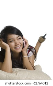 Attractive young Asian girl talking on the telephone