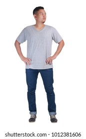 Attractive young Asian man standing posing wearing plain grey shirt, blank t-shirt mock up for  printing