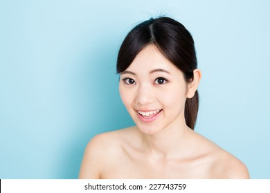 attractive young asian woman beauty image on blue background