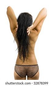 attractive, young asian woman dressed with slip only, photographed from behind, isolated on white