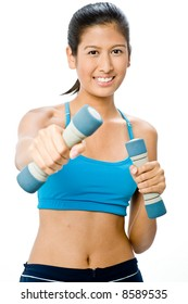 An attractive young Asian woman with dumbbells on white background