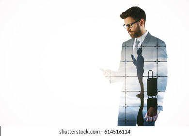 Attractive young bearded man using mobile phone on abstract airport background. Traveling concept. Double exposure