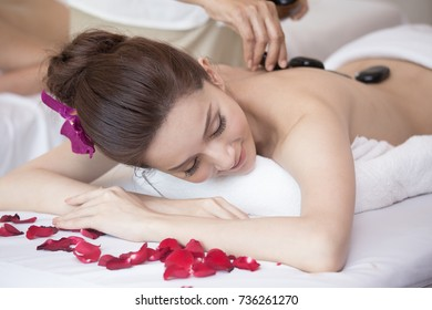 Attractive Young Beautiful Asian woman in Spa salon is having Massage, Spa, health and healing concept.