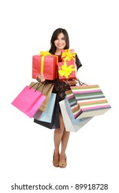 Attractive Young beautiful asian Woman with Shopping Bags and Box isolated on white isolated background