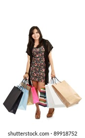 Attractive Young beautiful asian Woman with Shopping Bags isolated on in white background