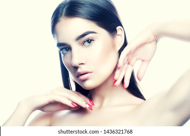 Attractive young beauty model woman posing. Nude make-up, natural lips, perfect skin, blue eyes, hairstyle, nail manicure, hands near face. Spa skincare health facial treatment youth concept