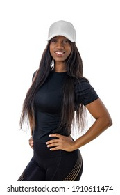 Attractive young black woman smiling and wearing workout clothes and a hat. Isolated studio shot with white background.