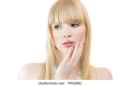 Attractive young blond woman touching skin on cheek isolated over white background