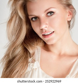 Attractive young blonde woman with long hair
