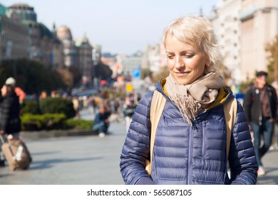 Attractive young blonde woman smiling