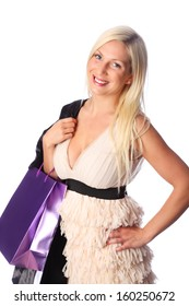 Attractive Young blonde woman wearing a dress, holding shopping bags. White background.
