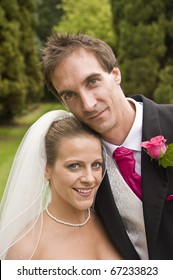 Attractive young bride and groom portrait outdoors