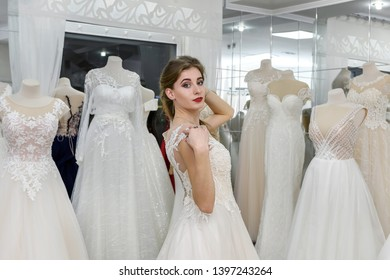 Attractive young bride is smiling in wedding salon