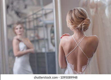 Attractive young bride in the store