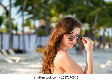 A attractive young brunette woman on a beach in Mexico