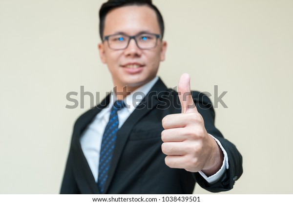 Attractive Young Business Man Showing Thump Stock Photo