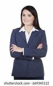Attractive young businesswoman in business jacket smiling looking away. Crossed her arms over her chest standing on white background