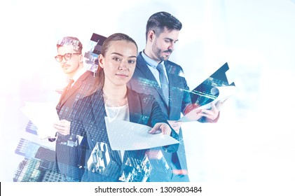 Attractive young businesswoman giving documents, man in glasses reading papers and businessman with clipboard standing together in city. Concept of paperwork. Toned image double exposure