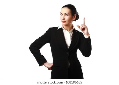 Attractive young businesswoman pointing her finger up isolated