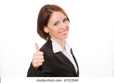 Attractive young businesswoman showing thumbs-up