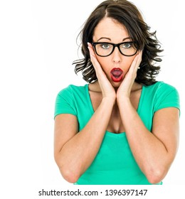 Attractive Young Caucasian Business Woman, With Brunette Hair, Wearing Black Framed Glasses, Looking Shocked And Surprised Gasping In Anticipation, Alone Against A White Background