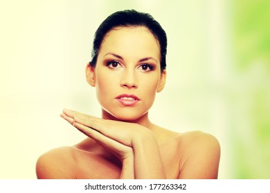 Attractive young caucasian woman face with perfect skin befour spa.