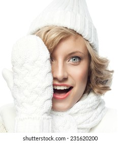 attractive young caucasian woman in warm clothing  studio shot isolated on white smiling happy toothy smile winter