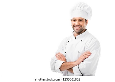attractive young chef with crossed arms looking at camera isolated on white