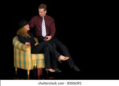 Attractive young classy couple, man proposing showing box with ring. Studio shot, black background.