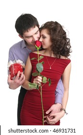 Attractive young couple with a gift and rose in hands isolated on the white background
