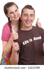 attractive young couple give thumbs-up sign - he wears 'life is good' T shirt - on white