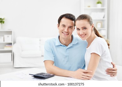 An attractive young couple at home