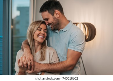Attractive young couple in love hugging.
